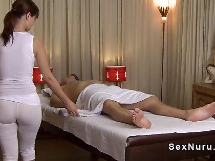 Super masseuse in undershirt gives massage