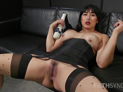 Asian whore sticks large toys in both holes during a rare unattended
