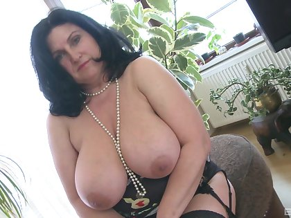 Fat uninspiring woman masturbates solo with her glass dildo and moans