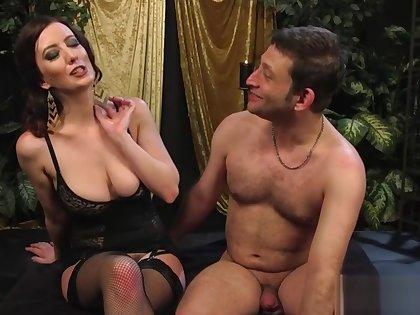 Big-breasted girl friend strapon-fucks her slave