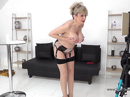 Lady Sonia oils up her tits then masturbates